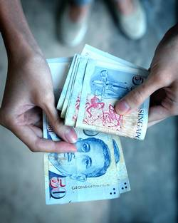 The latest survey showed the Singapore dollar will appreciate to S$1.23 per US dollar by the end of 2011